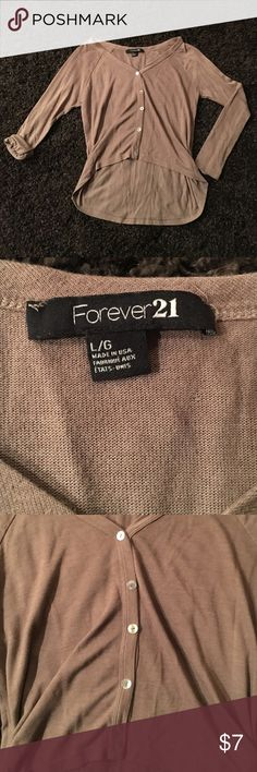 Forever 21 Top size large CUTE with no flaws,holes or stains.Buttons up the front.Slightly cropped bit longer in the back. Forever 21 Tops Button Down Shirts