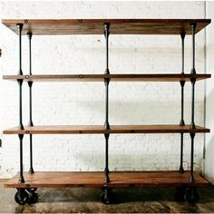 reclaimed timber for shelves. add plumbing pipes and castors. Perfect for the warehouse!