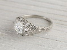 Gorgeous Art Deco vintage engagement ring made in platinum and centered with a .85 caratGIA certified old European cut diamond with J color and VS2 clarity. Circa 1920 Center diamond is prong set inside a hexagonal setting and accented with single cut diamonds in a classic deco setting decorated with millegrain edges. Beautiful deco lines in this 1920′s find. Learn more about Art Deco rings Diamond and gold mining has caused devastation in areassuch as Africa, wreaking havoc on delicate…
