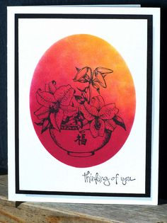 Asian themed card ... line image of bowl of lilies stamped in black ... masked over sponged in yellow and red ... lovely ...