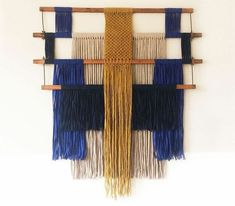 Macramé wallhanging made from pieces of an old weaving loom, leftover fabric strips and wool yarn Weaving Wall Hanging, Weaving Art, Loom Weaving, Tapestry Weaving, Hanging Fabric On Walls, Fabric Wall Hangings, Wool Wall Hanging, Fabric Wall Art, Macrame Art