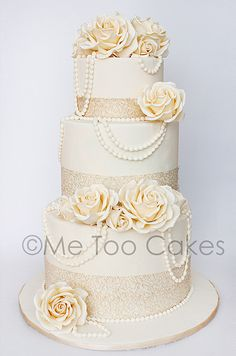 A fabulous wedding cake with flowers and pearls by Me Too Cakes.....What do you think about the string of silver beads?