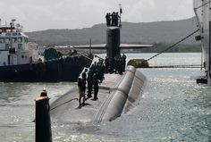 Los Angeles-class fast-attack submarine USS Olympia (SSN 717) arrived at Naval Base Guam,Sept.1,for port visit as part of deployment to Western Pacific.With crew of approx 150,Olympia will conduct multitude of missions.Over 360 feet long & almost 7,000 tons submerged,one of most stealthy,swift,& lethal submarines in world.Capable of supporting multitude of missions,including anti-submarine warfare,anti-surface ship warfare,& intelligence,surveillance,& reconnaissance.