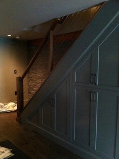 Under stair storage / cable railing  Sudbury - contemporary - basement - boston - by Pinney Designs