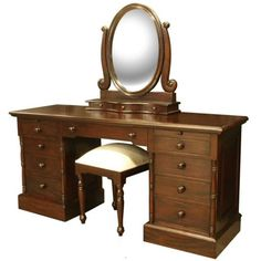 Impressive solid wood dressing table with twin pedestals. Each pedestal has four drawers above which is a pull out shelf to give extra table top area for say a hair dryer or tongs. An oval mirror resting on 3 further small 'jewellery' drawers completes the top. A fuller length drawer [...]