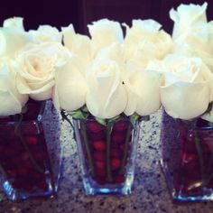 LOVE WHITE ROSES!! cranberries and roses centerpiece