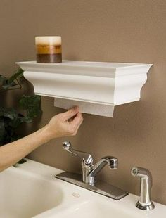 Use a piece of crown molding to hide paper towels. Brilliant! The Detailed Decorator LLC