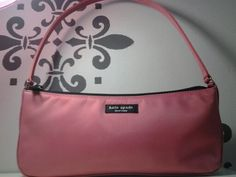KATE SPADE PINK NYLON BAGUETTE #12324 $ 17.99  I love classic wear-everywhere pieces that can transition through the seasons and pair with virtually anything in the closet - that's why I think  this baguette to embody that same philosophy. The smooth Pink nylon construction lends a timeless essence, while the structured design and partially single strap translates modern chic. Best part of all, this piece is totally lightweight so it'll rest comfortably on your shoulder without tiring you…