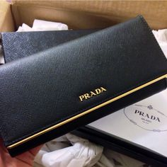 Prada is one of the most recognized and a leading brand in the fashion world. Founded in 1913 by Mario Prada, the designer has long history of Prada Clutch, Prada Wallet, Prada Purses, Prada Handbags, Prada Bag, Handbags On Sale, Purse Wallet, Purses And Handbags, Leather Handbags
