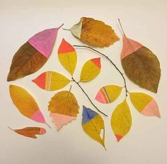 Paint-Dipped Leaves - The minimalist effect created here with just paint and leaves is striking.