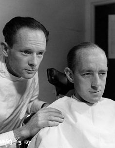 Alec Guinness in the makeup chair.