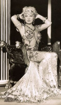 """MAE WEST in I'm No Angel (1933) In this sexy sequinned costume by Travis Banton, Mae belts out 'They Call me Sister Honky Tonk' in her trademark bawdy style. """"I've got the face of a saint, on the level it ain't paint. But beware of these eyes, I'm a devil in disguise…. and they call me Sister Honky Tonk."""" (please follow minkshmink on pinterest) #maewest #theycallmesisterhonkytonk #sexsymbol"""