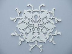 Chrysanthemum placemat. Laser cut by Venucci. I wanted to make a clock out of one of these (adhere it to a natural wood base & add the dial) but the white ones are no longer available. may create a stencil like it instead