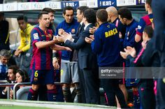 Xavi Hernandez of FC Barcelona shakes hands with Head coach Luis Enrique Martinez after being substituted during the La Liga match between FC Barcelona and RC Deportivo La Coruna at Camp Nou on May 23, 2015 in Barcelona, Spain.