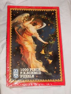 "Beautiful 'Midnight Angel' 1000 piece Jigsaw Puzzle by FX Schmid #FXSchmid  New, unopened 1000 piece jigsaw puzzle by FX Schmid.  Image: the beautiful 'Midnight Angel' often seen on Christmas cards and stamps.  Still in cellophane, box slightly dented but otherwise perfect.  Finished puzzle dimensions: 20"" x 27"" .  Box size: 15.5""x 10.25"" x 2.25""   $15.99 OBO.  Flat rate Priority shipping $17.90"