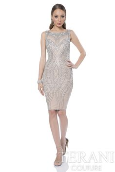 Illusion V neck cocktail dress with intricate linear bead work. This short dress features a low back cut out.