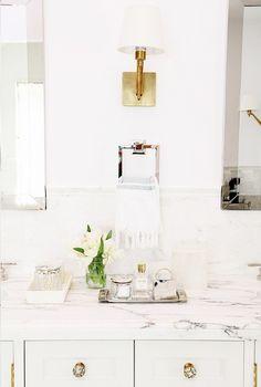 sconce between vanity mirrors