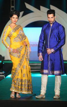 Rohit Verma long sleeved yellow sari blouse and blue men's sherwani. More photos - http://www.indianweddingsite.com/marigold-watches-rohit-verma-fashion-show/