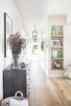 Home Interior Loft Lakeview Home Entryway Reveal + Metal cabinet + wooden shelf niche + hanging lanterns + wax flowers + York Gray by Benjamin Moore on the walls + Vanilla Milkshake for the trim Home Interior, Interior Design, Kitchen Interior, Hallway Designs, Modern Farmhouse Kitchens, Vintage Farmhouse, Wooden Shelves, Walnut Shelves, Built Ins