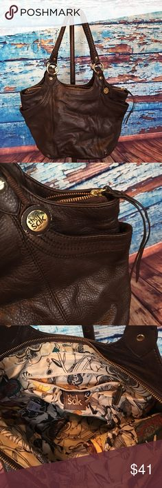 The SAK Handbag.  Pre-Loved! Don't get me lying & naming handbag types!  This bag is in near perfect condition other than wear on the Wooden SAK leather attachment.  I loved this bag, but I don't even carry handbags anymore.  Pretty sad. The Sak Bags Shoulder Bags