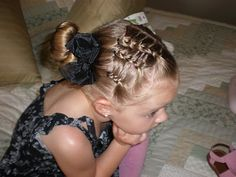 One sided french braids, on sides in front, then pulled into a bun.