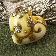 Kerri Fuhr and her amazing scrollwork on a heart shaped bead.