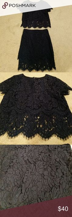 Lulus two piece apparel Navy blue. Lace. Never worn. Didn't fit me and I never exchanged it. Skirt has hidden zipper in back. Top has tiny button clasp in back. Lulu's Other