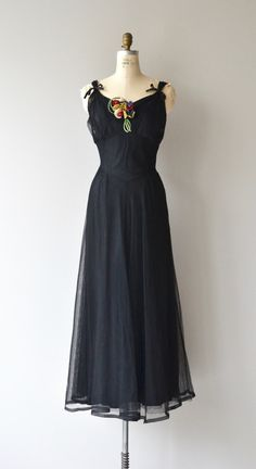 Vintage 1930s formal black sheer net lace gown with black rayon slip, wide set bow detailed shoulders, seamed bust, felt flower corsage (removable), seamed waist (unseamed slip waist), lovely movement on the skirt and metal side zipper. --- M E A S U R E M E N T S ---  fits like: medium bust: 36 waist: 30 hip: free length: 56 brand/maker: n/a condition: excellent  ✩ layaway is available for this item  To ensure a good fit, please read the sizing guide…