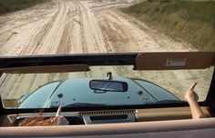 A jeep headed towards the beach.Basically the perfect car going on the perfect adventure.