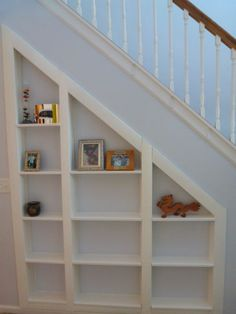 secret room under stairs and shelves - will do in the farm's kitchen someday.