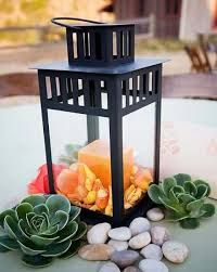 lantern and succulents centerpiece