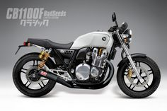 CB110 cafe racer, poor mans bonneville perhaps. Looks really good though!