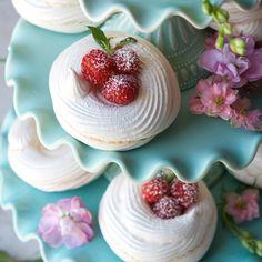 Homemade meringues with red raspberries.