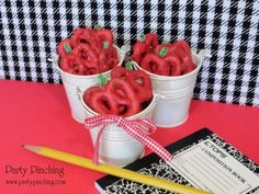 "Cute little ""apples"" to snack on!  Pretzels dipped in red candy melts - add a little green apple sour rope for the stem and you get the yummy apple taste too!"