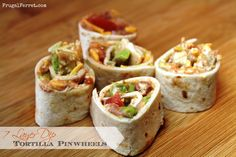 7 Layer Dip Tortilla Pinwheels ...What a great snack food for the crowd...and popular with the kids and the adults!