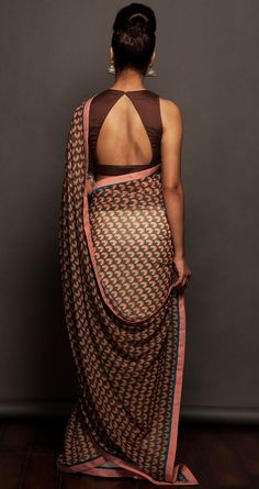 some sarees just dont need any embellishments... could also be worn with a peach colour blouse