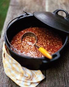 Slow-Cooked Baked Beans - Coated in a glistening sweet-and-spicy sauce, navy beans cook to a creamy consistency while still holding their shape. A bit of bacon lends a rich smokiness to the dish.