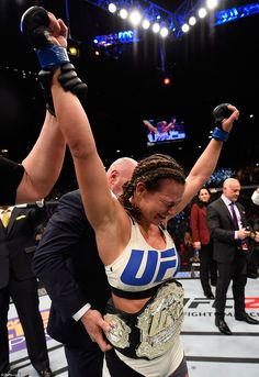 Overjoyed: Miesha Tate reacts to her victory over Holly Holm. She is pictured wearing the UFC victory belt as she holds back tears of joy