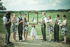 Picture idea with the wedding party: picture frame photo!