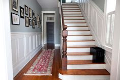 An 1890 three-bedroom frame house built in 1890 in Charleston, S.C. House has a side-hall floor plan. I love the long hall next to the stairs, with the pictures hanging up. A great entrance to a house.