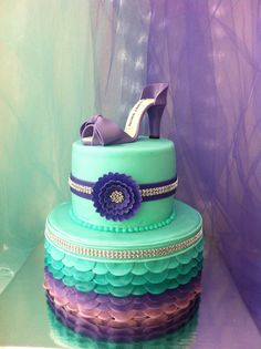 Purple and teal high heel cake. Celebration of Life Cake for Melaney Jayne Holden. For a little girl who fought hard to overcome cancer. She loved teal and purple and heels. I hope this cake makes her smile down from Heaven