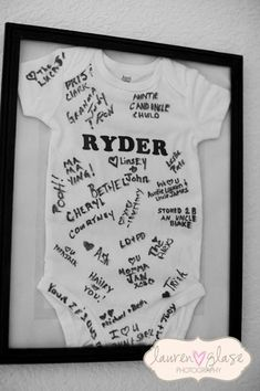 Baby shower onesie guestbook. Use a piece of paper to block space for the name if you want to make the name a surprise.