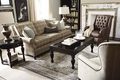 Carlisle Sofa by Bassett Furniture features a semi-attached back with a graceful roll, classic round setback panel arms and elegant turned legs.