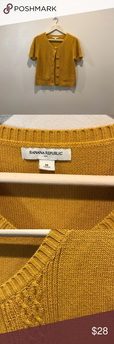 Banana Republic short sleeve Cardigan size Medium Beautiful preloved Banana Republic Short sleeve Cardigan. This Sweater is a mustard yellow and a size Medium. If you have any questions please ask 💕💕 Banana Republic Sweaters Cardigans