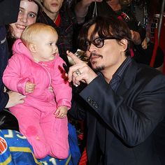 Johnny Depp spends some time with a young fan at the London premiere of The Rum Diary on Thursday. Friday, November 4, 2011