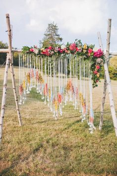 Boho alter with birch tree poles, a handmade yarn hanging, and all the pretty blooms! #cedarwoodweddings | Cedarwood Weddings