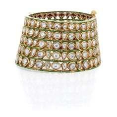 Indian Gold, Foiled-Back Diamond and Jaipur Enamel Cuff Bangle Bracelet The wide tapered pierced cuff composed of multiple rows of foiled-back table-cut diamonds, edged by gold, spaced by slender green enamel bands, the reverse applied with green, red and white Jaipur enamel, approximately 92.7 dwt. Inner circle 6 1/2 inches.