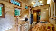 his tiny mobile house is gorgeous on the outside, but the inside? It's got one thrilling surprise I've never seen in a tiny house before! Best Tiny House, Tiny House On Wheels, Small House Plans, Tiny House Stairs, Tiny House Living, House Ladder, Living Room, Bungalows, Tiny House Mobile
