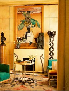This apartment of a Parisian antique dealer was featured in World of Interiors. It a great example of Art Deco style.