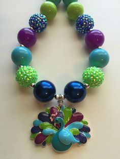 A personal favorite from my Etsy shop https://www.etsy.com/listing/399610749/gorgeous-peacock-chunky-bead-necklace